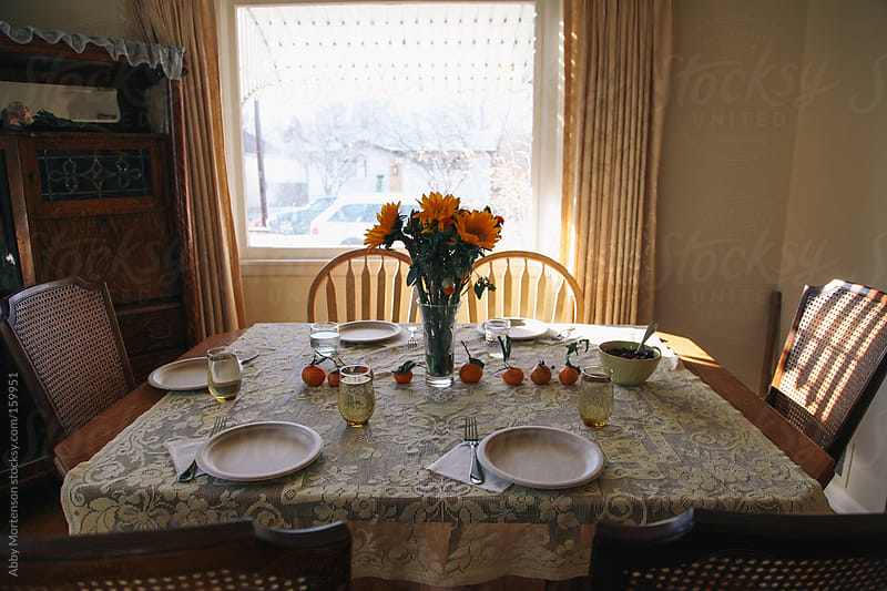 Table Setting with Flowers  by Abby Mortenson for Stocksy United