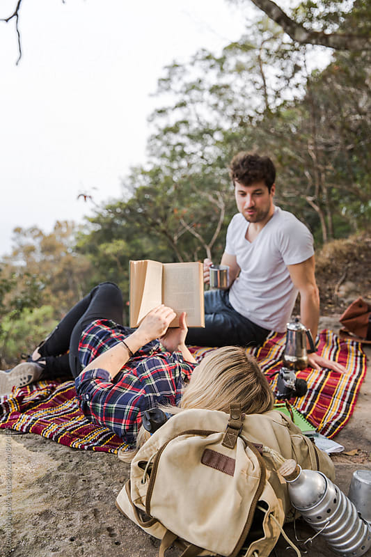Couple relaxing at picnic together by Jovo Jovanovic for Stocksy United