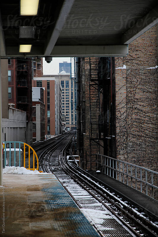 Looking down metro train line from platform by Tari Gunstone for Stocksy United