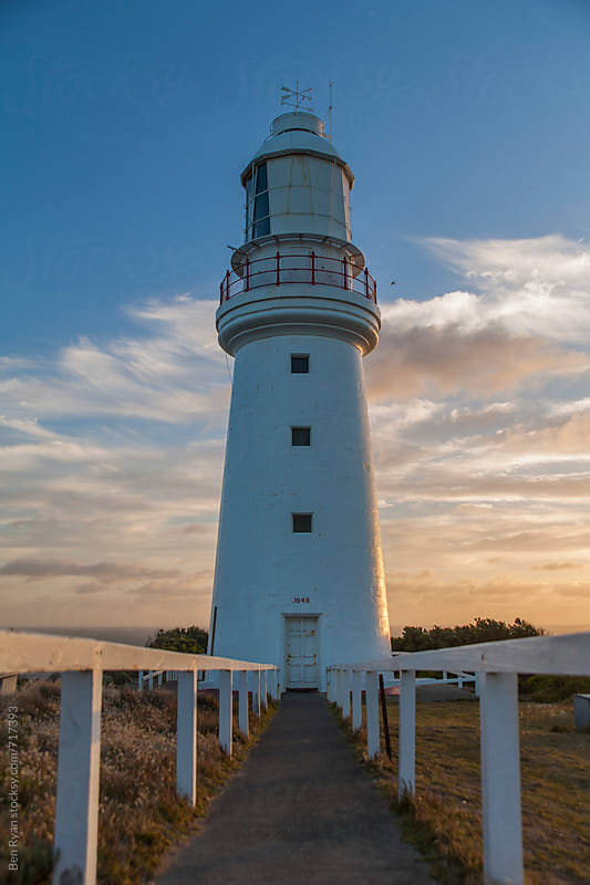 Remote lighthouse at sunset by Ben Ryan for Stocksy United