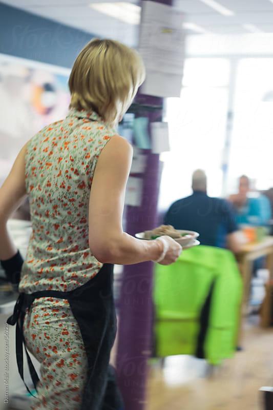 Busy Waitress. by Darren Muir for Stocksy United