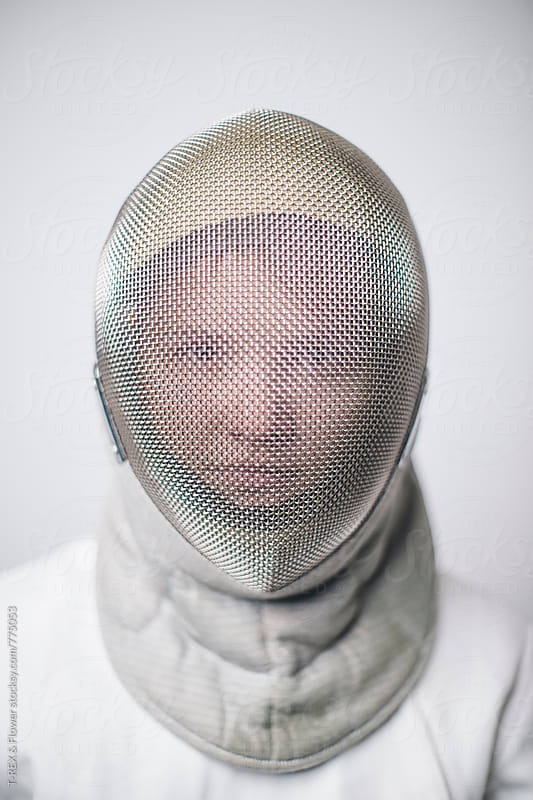 Close-up of female fencer in mask by T-REX & Flower for Stocksy United