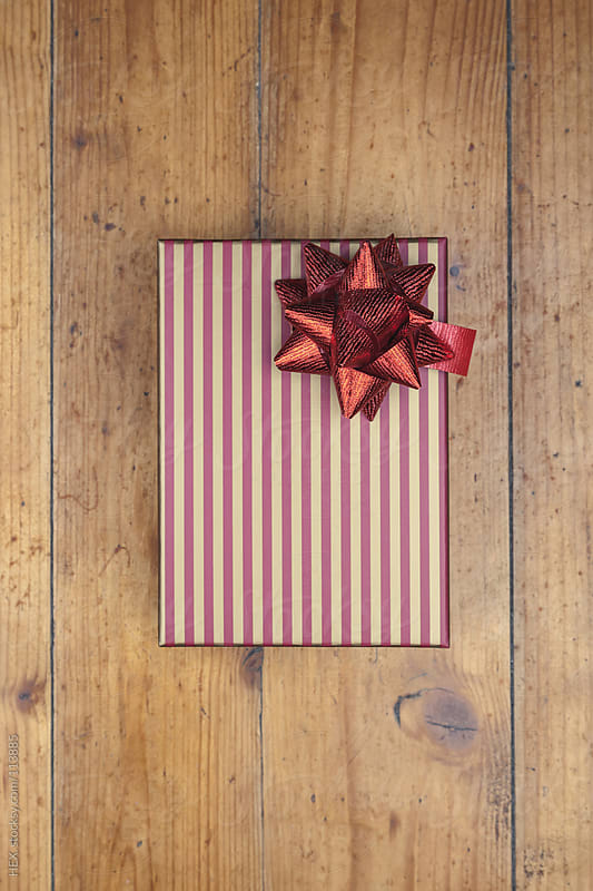 Christmas Gift Box on the Floor by HEX. for Stocksy United