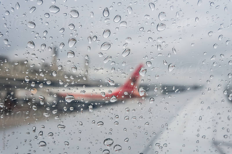 Raindrops on the plane's window by Mauro Grigollo for Stocksy United