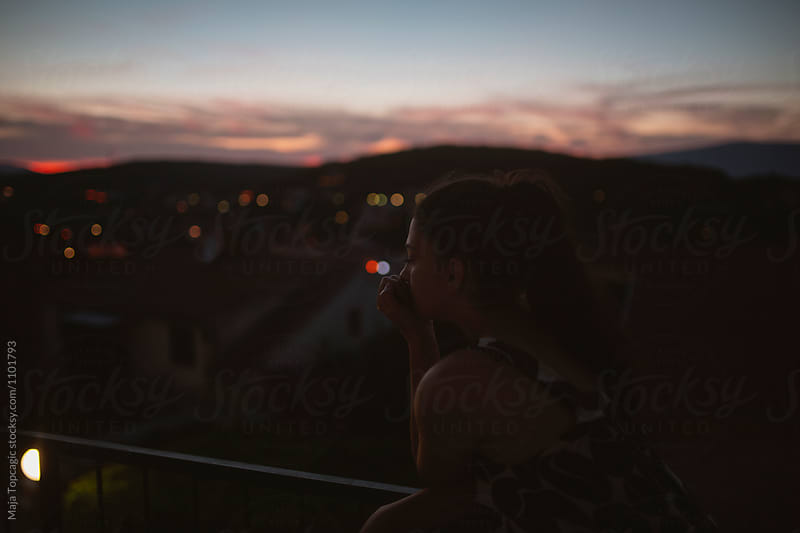 Silhouette of a woman at night by Maja Topcagic for Stocksy United