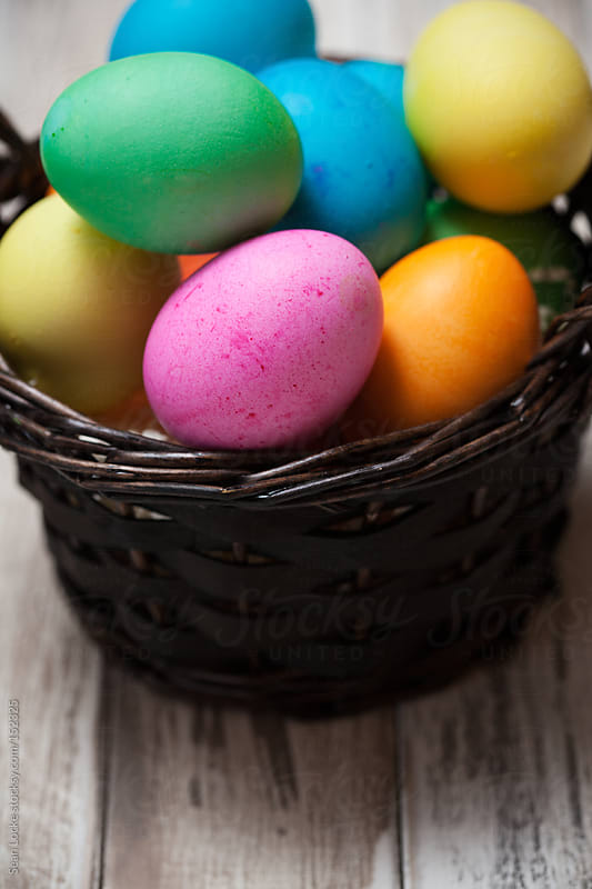 Easter: Basket Full Of Colorful Eggs with Copyspace at Bottom by Sean Locke for Stocksy United