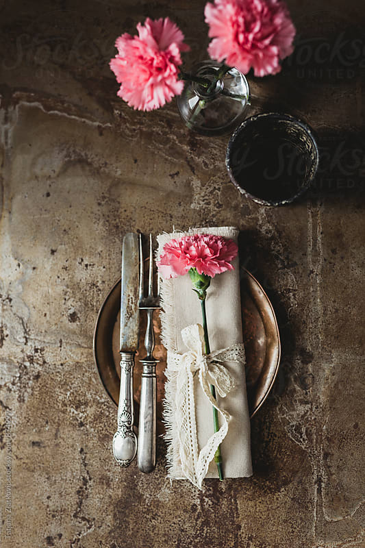 Place setting with carnation by Tatjana Ristanic for Stocksy United