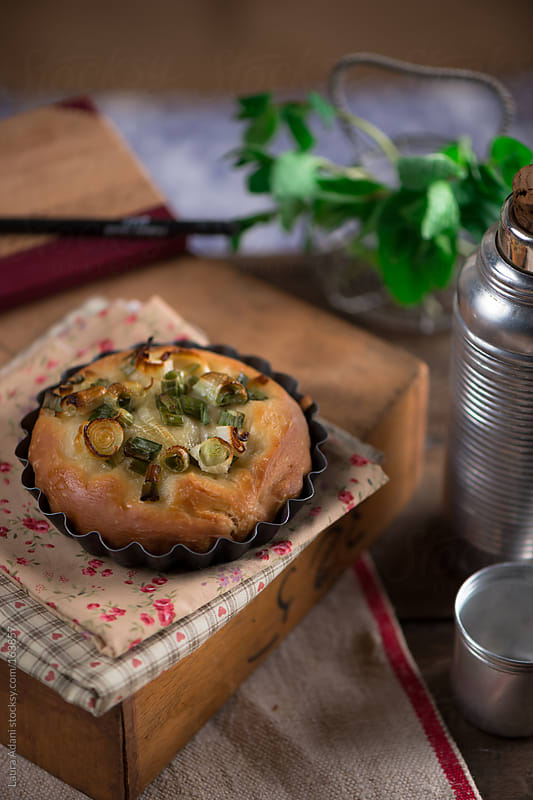 a onion and mint focaccia by Laura Adani for Stocksy United