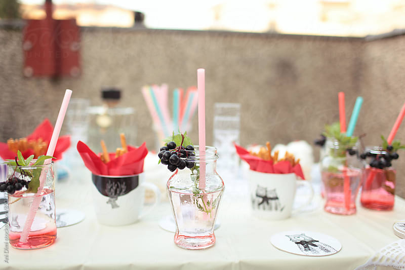 Drinks and snacks for roof  party  by Ani Dimi for Stocksy United