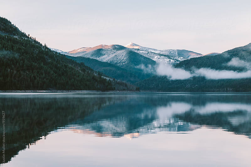 Beautiful sunrise reflected in mountain lake.  by Justin Mullet for Stocksy United