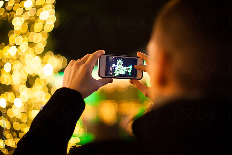 Anonymous Man Taking Photos of Christmas Scene by Mosuno for Stocksy United