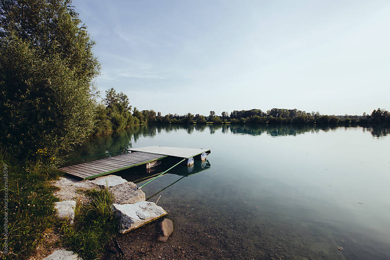 Pier at lake landscape in summer by Robert Kohlhuber for Stocksy United