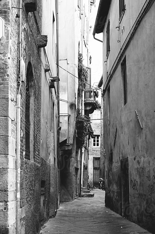 Looking down a winding side street in Italy by Sarah Lalone for Stocksy United