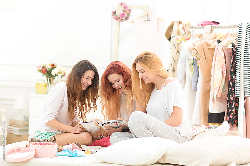 Teenage Girls Reading a Fashion Magazine by Lumina for Stocksy United