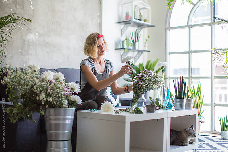 Woman making spring floral decorations  by Jovo Jovanovic for Stocksy United