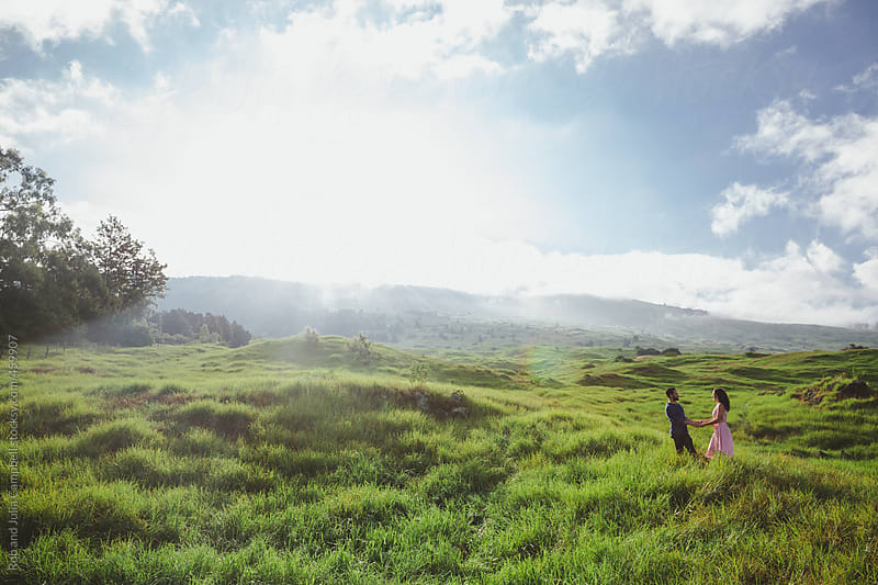 Young, romantic couple together outside - wide, scenic view of lush nature by Rob and Julia Campbell for Stocksy United