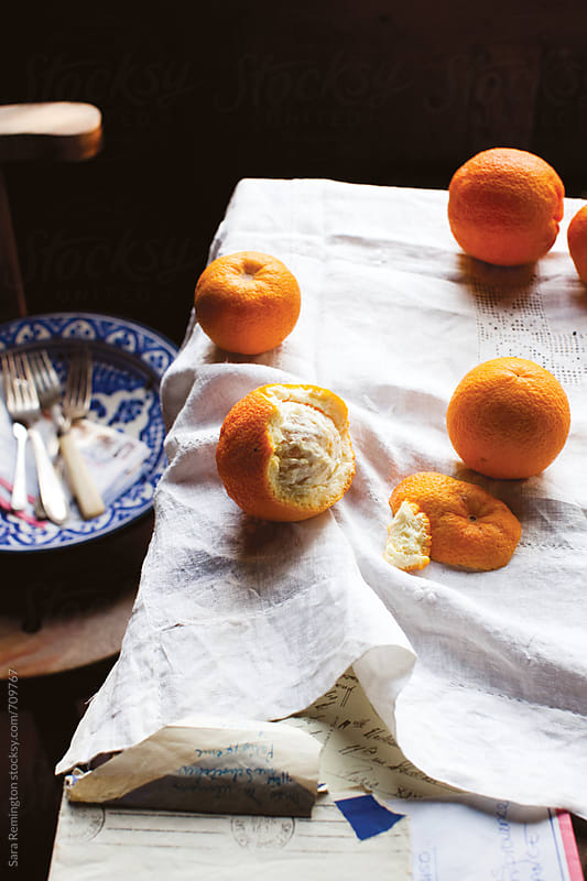 Peeled Oranges on Table by Sara Remington for Stocksy United
