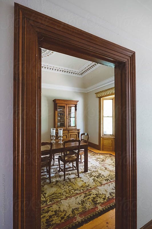 Looking through doorway to dining room in Country Homestead by Rowena Naylor for Stocksy United