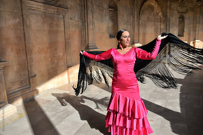 Two professional flamenco dancers in Carlos V Palace, Granada by Bisual Studio for Stocksy United