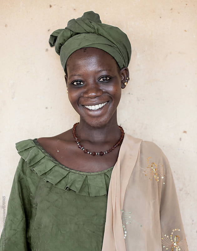 Portrait of smiling female. Mali by Hugh Sitton for Stocksy United