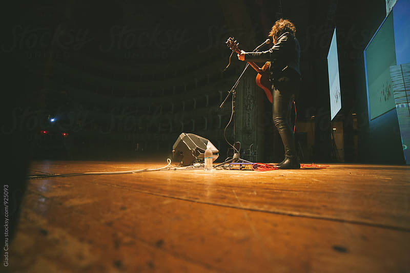 Musician playing in a theatre by Giada Canu for Stocksy United