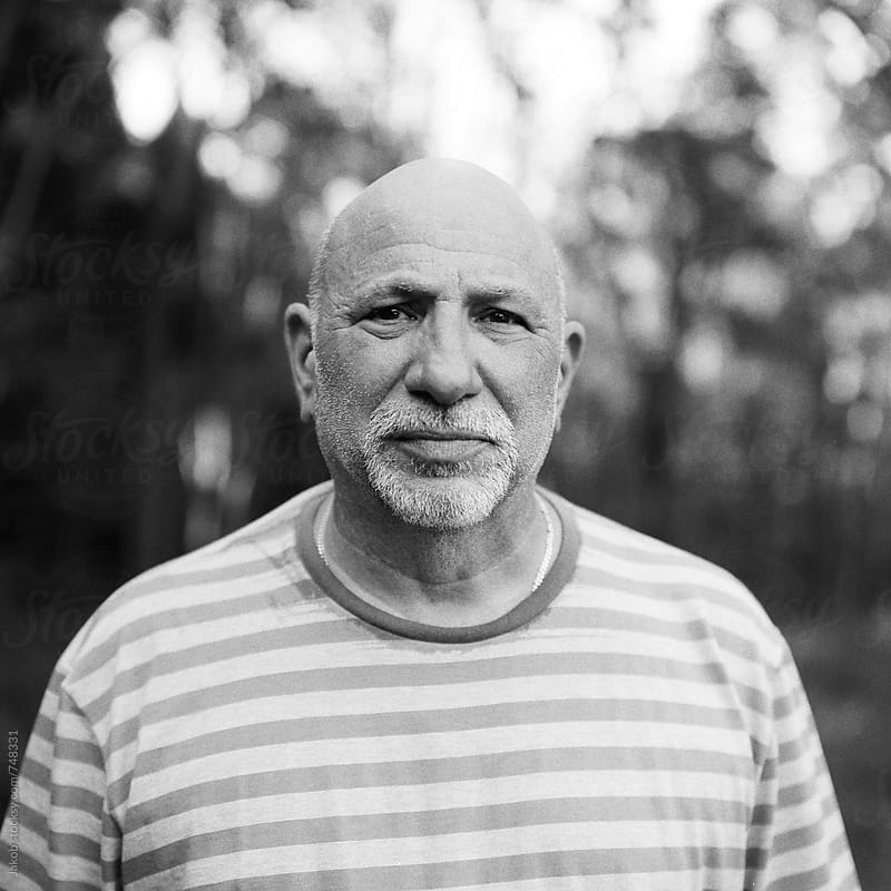 Black and white portrait of an older man by Jakob for Stocksy United