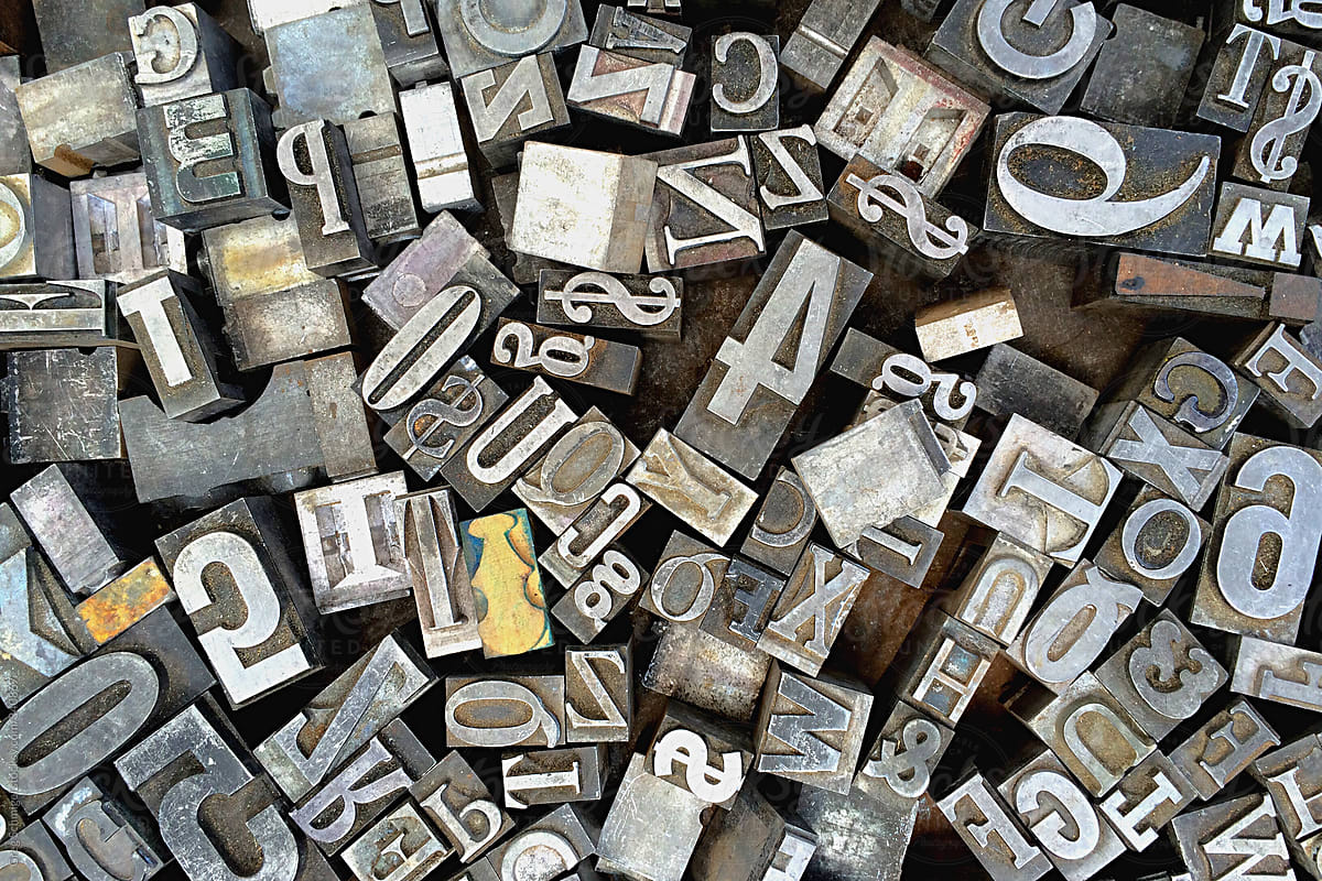 Old antique metal printing letters from a printing press by