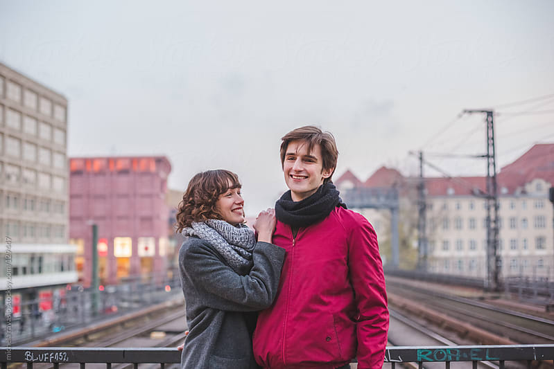 Young couple at the train station by michela ravasio for Stocksy United