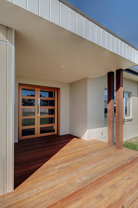 Entrance to a modern home by Rowena Naylor for Stocksy United