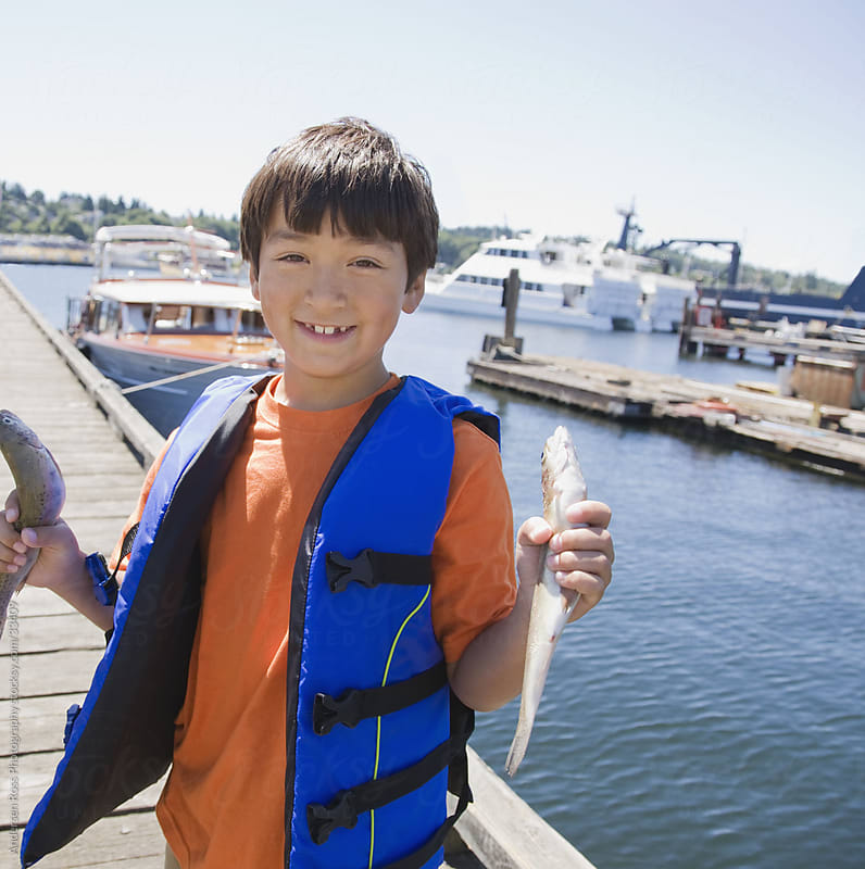 Portrait of boy (8-9) on yacht by Andersen Ross Photography for Stocksy United