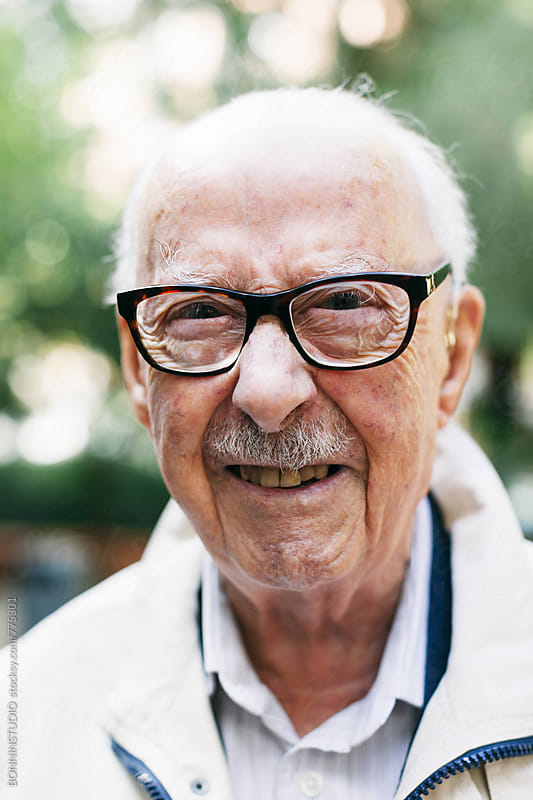 Portrait of a smiling elderly man. by BONNINSTUDIO for Stocksy United