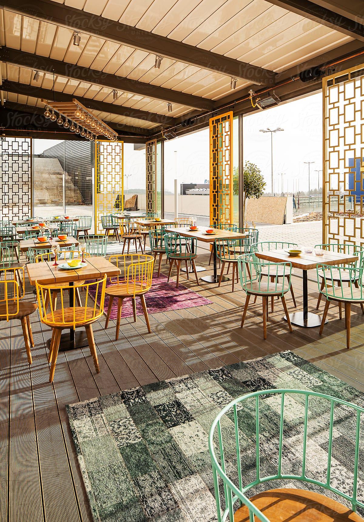 Exterior Of Modern Colorful Cafe By Sunrise By Aleksandar Novoselski Stocksy United