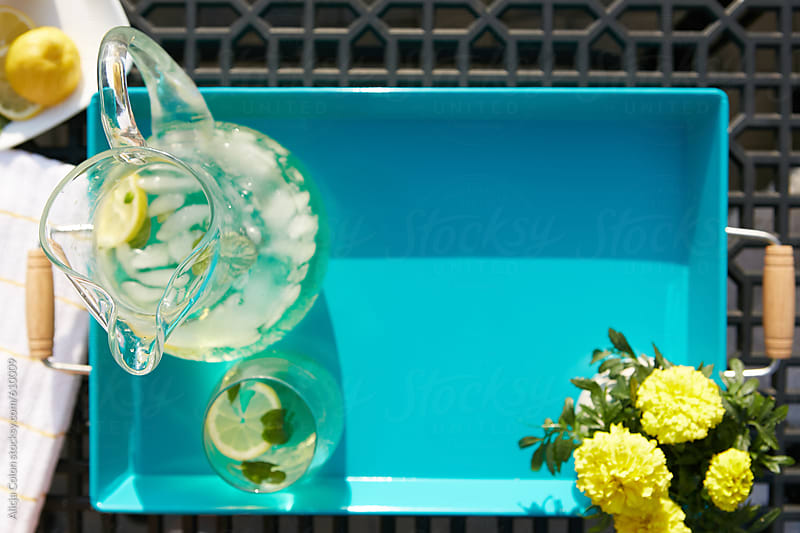 Overhead lemonade serving tray by Alicja Colon for Stocksy United
