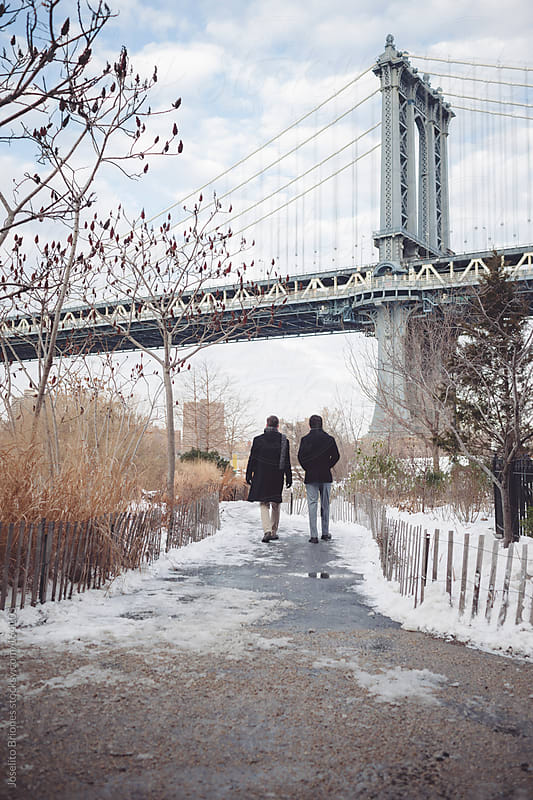 Friends Hanging Out in Dumbo Brooklyn on a Winter Afternoon by Joselito Briones for Stocksy United