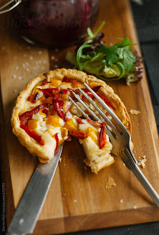 Goats cheese tart. by Darren Muir for Stocksy United
