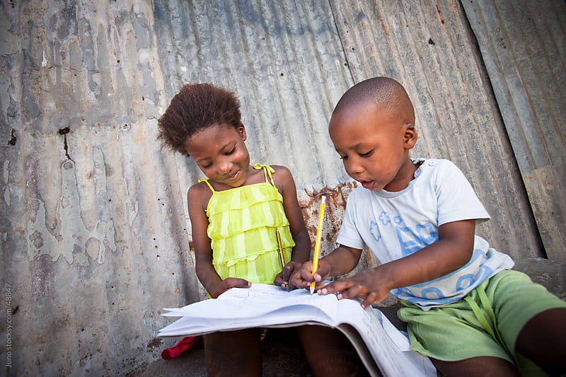 Cute African kids doing homework by Micky Wiswedel for Stocksy United
