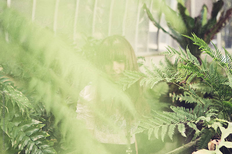 Young woman into the botanical garden. by Carles Rodrigo Monzo for Stocksy United