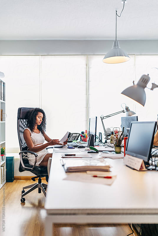 Black Businesswoman Working at the Office by Victor Torres for Stocksy United