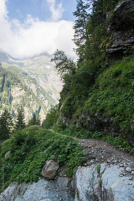 Hiking trail in alpine valley  by Peter Wey for Stocksy United