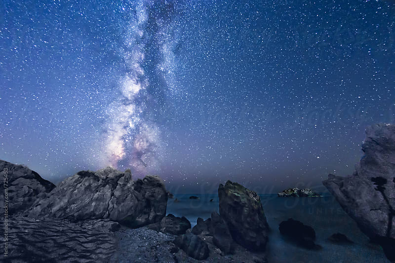 The Milky Way over a Rocky Short at Lefkada Greee by Helen Sotiriadis for Stocksy United