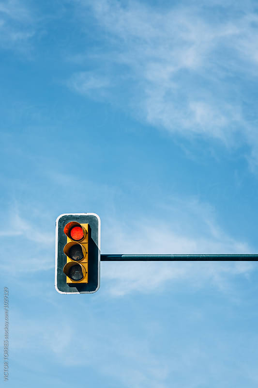 Traffic Light Against a Blue Sky by Victor Torres for Stocksy United