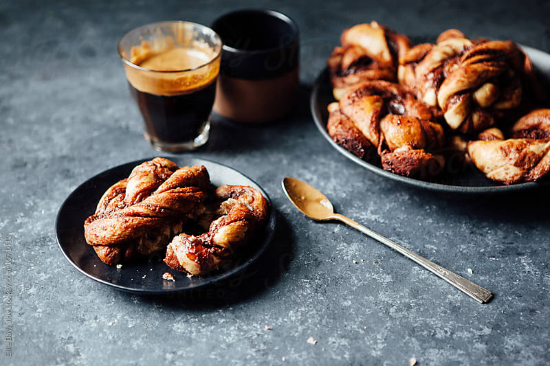 Chocolate buns with a cup of expresso by Ellie Baygulov for Stocksy United