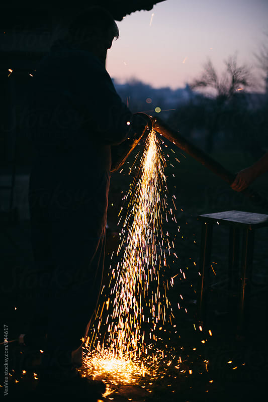 Welder working during the night  by Marija Mandic for Stocksy United