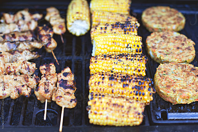 Barbecue / BBQ food in summer by Natalie JEFFCOTT for Stocksy United