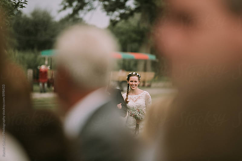 Bride Walking Down the Aisle at Her Outdoor Wedding by Rachel Gulotta Photography for Stocksy United