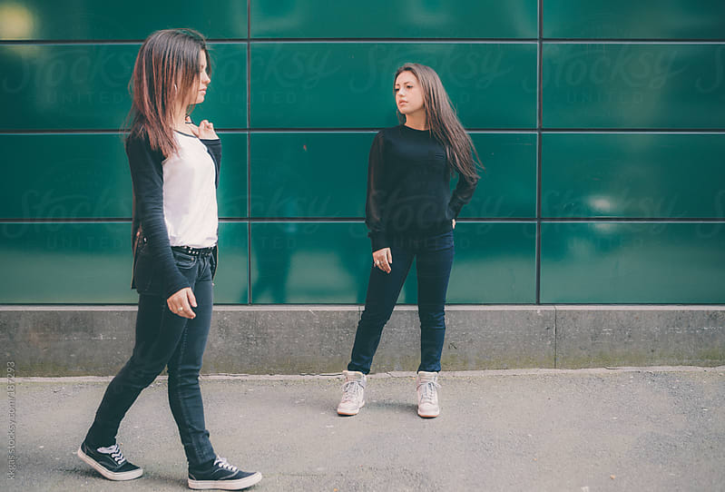 Twin teenage girls in the street by kkgas for Stocksy United