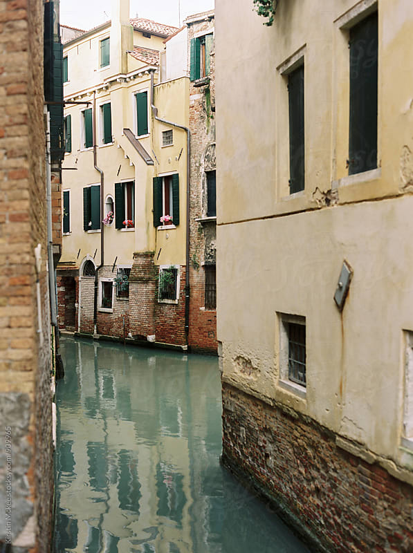 Canal in Venice with reflections by Kirstin Mckee for Stocksy United