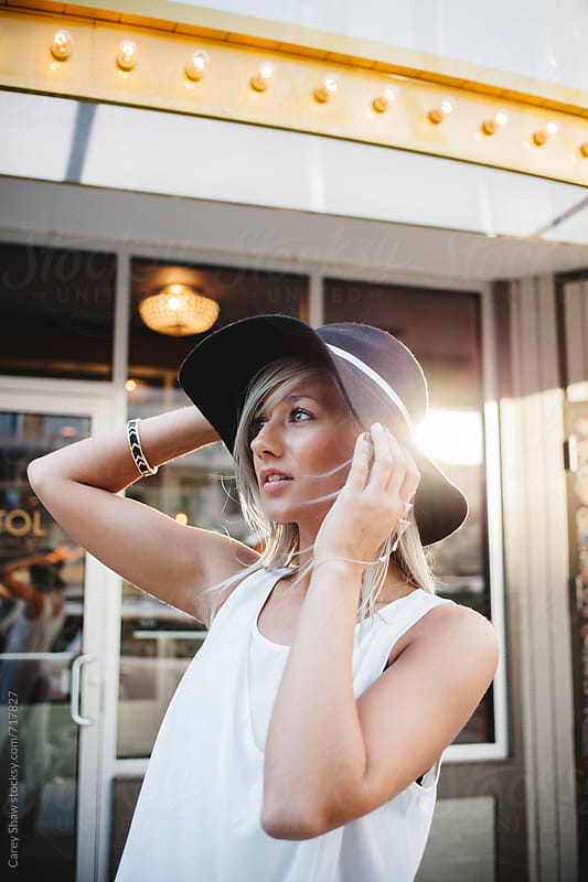 Portrait of beautiful woman holding stylish hat by Carey Shaw for Stocksy United