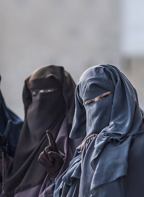 traditional Muslim women in North Africa, religious believers in the Medina by Igor Madjinca for Stocksy United