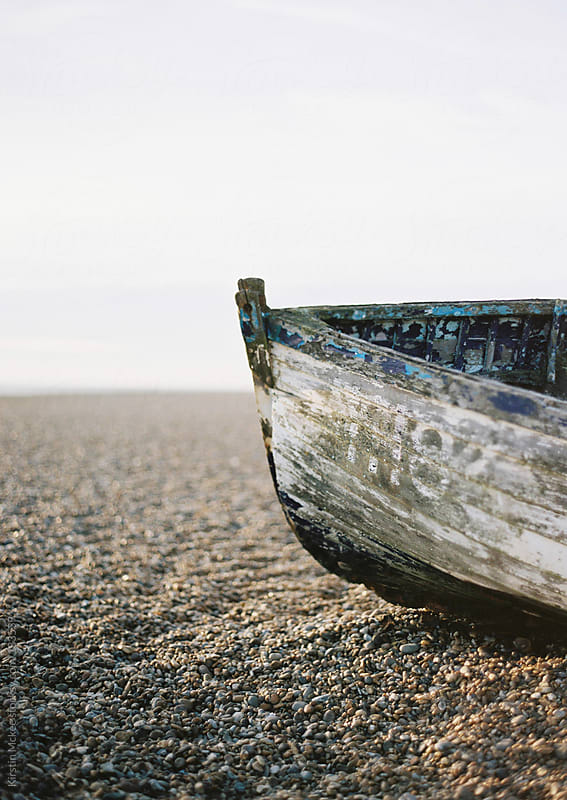 Portrait of a boat on a beach.  by Kirstin Mckee for Stocksy United